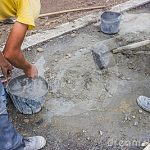 http://thumbs.dreamstime.com/x/workers-mixing-concrete-hand-worker-curbs-new-sidewalk-34582732.jpg
