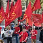 http://i.dailymail.co.uk/i/pix/2016/05/01/17/33B659C200000578-3568271-Communists_with_banners_featuring_Soviet_dictator_Stalin_were_am-m-30_1462119758377.jpg