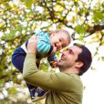 https://thumbs.dreamstime.com/t/father-holding-little-son-throwing-him-air-his-green-tree-68641813.jpg