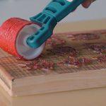 https://www.epiloglaser.com/assets/img/blog/franchising-vs-starting-a-laser-business/engraved-stamp-painting.jpg