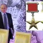 https://secure.i.telegraph.co.uk/multimedia/archive/02551/putrin-medal_2551375b.jpg
