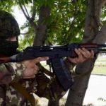 Slikovni rezultat za a civilian walks around town with a Kalashnikov