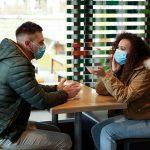 https://us.123rf.com/450wm/belchonock/belchonock2003/belchonock200310674/142357875-couple-with-disposable-masks-in-cafe-virus-protection.jpg?ver=6