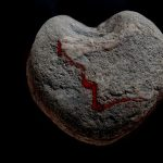 https://us.123rf.com/450wm/hoerby/hoerby1402/hoerby140200002/25772932-heart-shaped-stone-with-a-bloody-disruption-in-front-of-a-black-background.jpg?ver=6